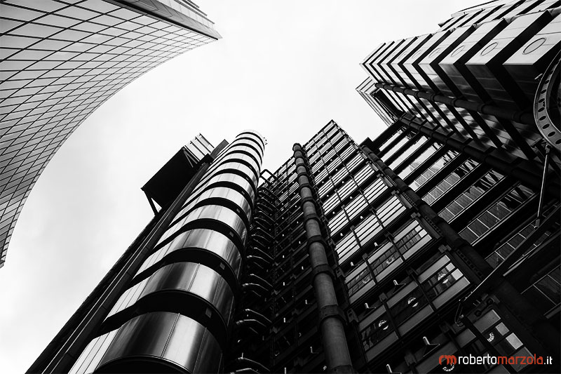 Lloyd's Building of London ,Glass City of London  England  london tower modern Office Block Reflection londra Built Structure Building Exterior Building Lloyd's Building Great Britain UK Low Angle View black and white